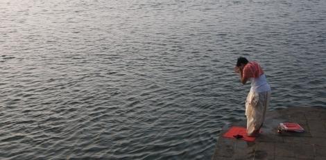 Giving prayer to Narmada